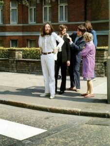 The Beatles preparing to cross the Abbey Road zebra crossing